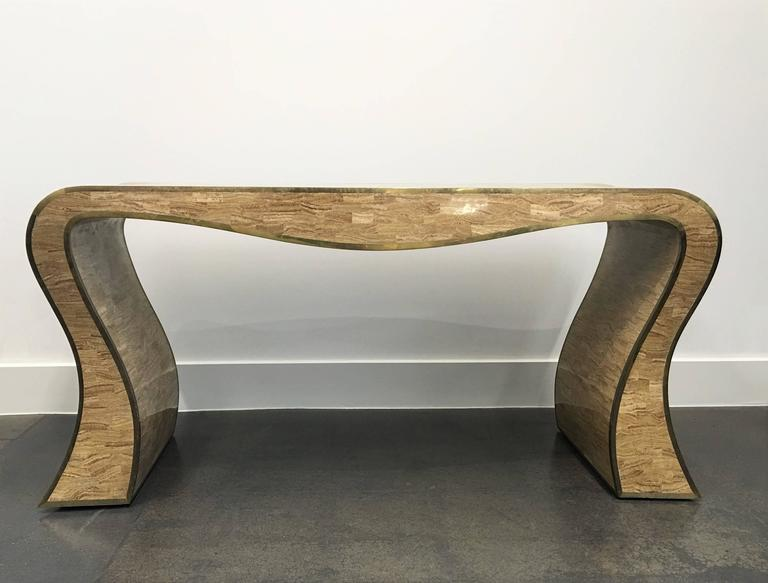 Exceptional tessellated stone over wood console table with brass inlay by Maitland-Smith. Made in the Philippines, where Karl Springer's similar designs were manufactured. The brass trimmed is of the finest craftsmanship.