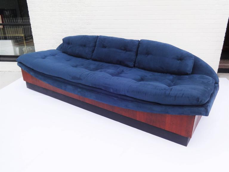 Vintage sculptural Gondola sofa designed by Adrian Pearsall for Craft Associates USA, circa 1965. The sofa floats above a matte black recessed platform and a 9.25 inch strip of walnut wood. Upholstered in blue fabric.