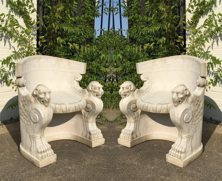 Pair of figural cast stone tub chairs. Wonderfully winged lion type figures with both carved heads and bodies.