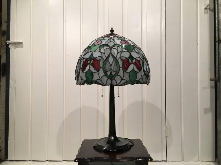 A Tiffany Style lamp is a type of lamp with a glass shade made with glass designed by Louis Comfort Tiffany and his design studio. The most famous was the stained leaded glass lamp. Tiffany lamps are considered part of the Art Nouveau movement.  Due