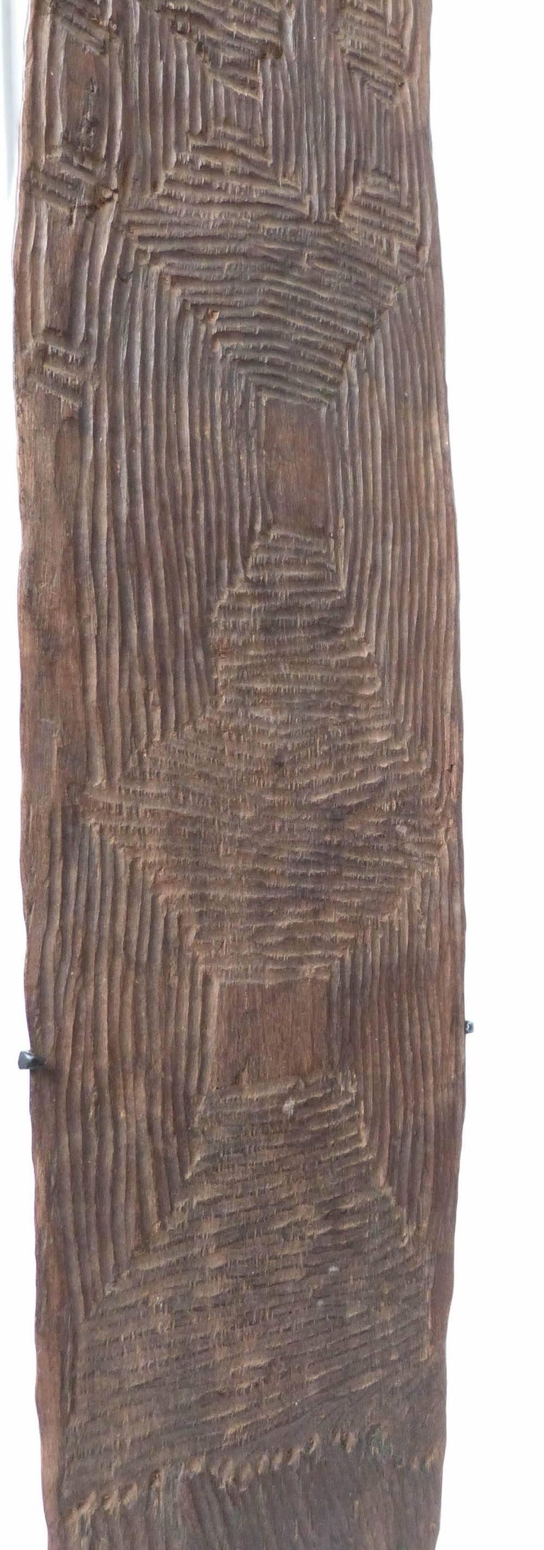 A lovely old Churinga, fine soft patina on both sides from rubbing during Aboriginal ceremonies. Deep vertical and linear carved design, done with a possum tooth or kangaroo claw. Traces of red ochre wash.