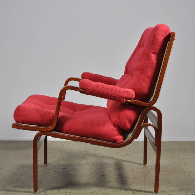 Fully restored example of the Classic Ingrid chair. This original DUX stamped item has been reupholstered in red Maharam Divina melange 531 felt fabric.  A sturdy wide design. The ingrid uses a angled bentwood frame and deep generous seat