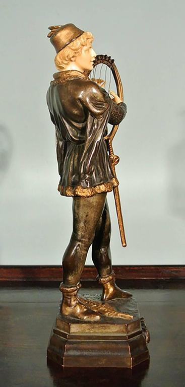 Bronze and ivory figure by jean didier debut titled barde