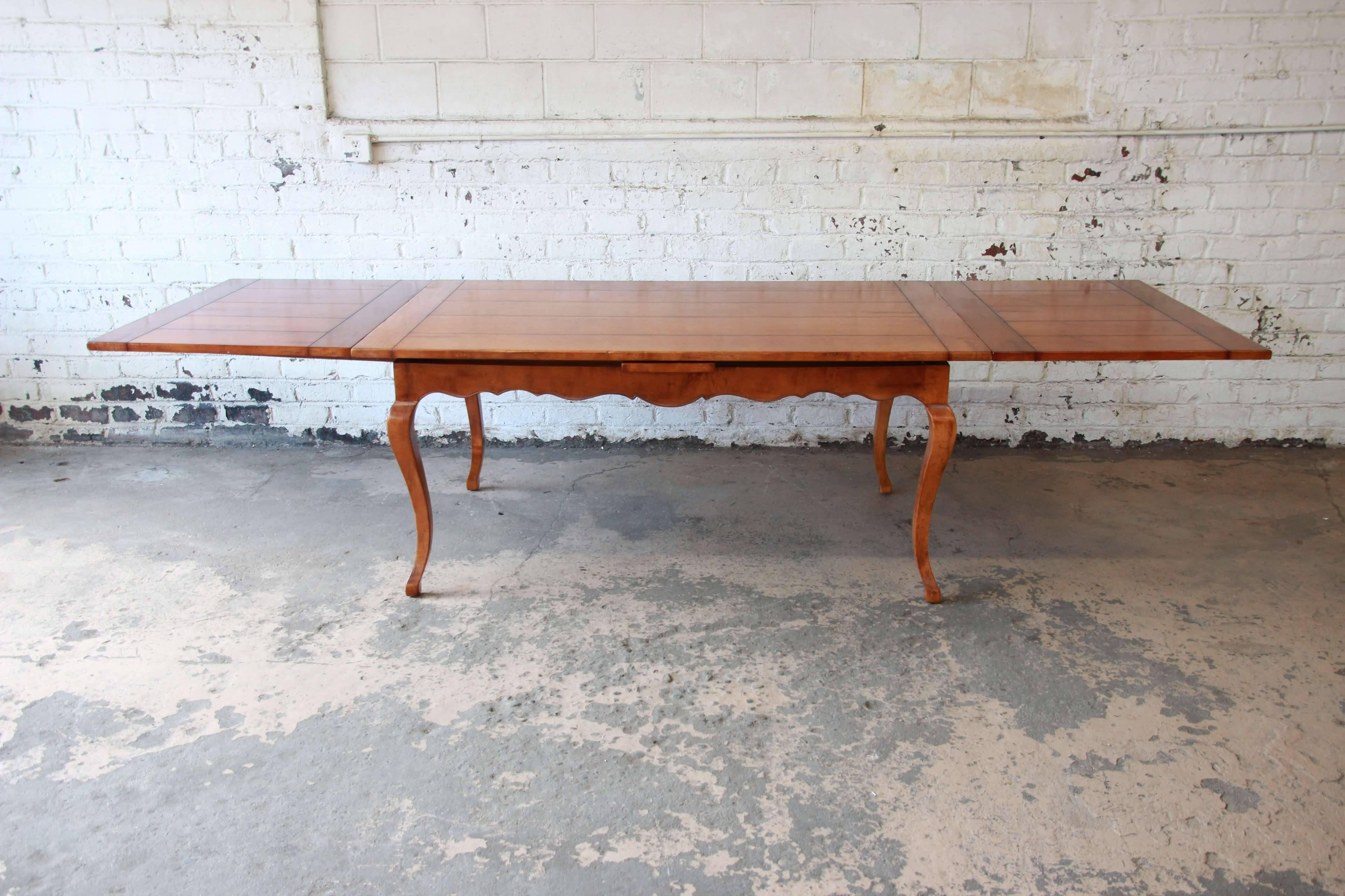 Offering A Beautiful Vintage Solid Maple Extension Dining Table By Baker  Furnitureu0027s Milling Road Division.