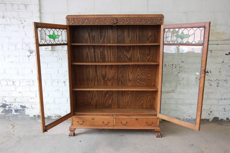 American Antique Carved Oak Bookcase with Leaded Stained Glass Doors, circa 1900 For Sale