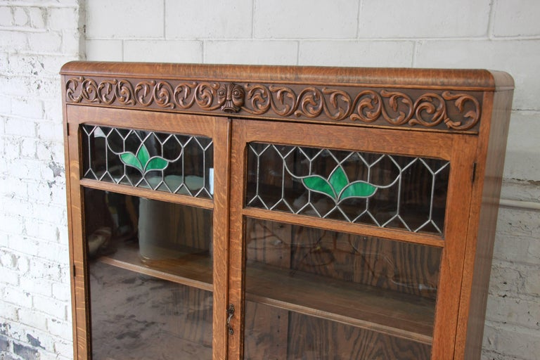 Arts and Crafts Antique Carved Oak Bookcase with Leaded Stained Glass Doors, circa 1900 For Sale