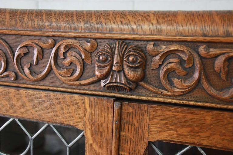 Antique Carved Oak Bookcase with Leaded Stained Glass Doors, circa 1900 In Excellent Condition For Sale In South Bend, IN