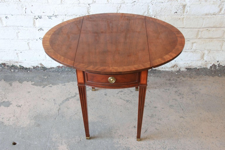 Late 20th Century Baker Furniture Mahogany and Inlaid Satinwood Drop-Leaf Side Table For Sale