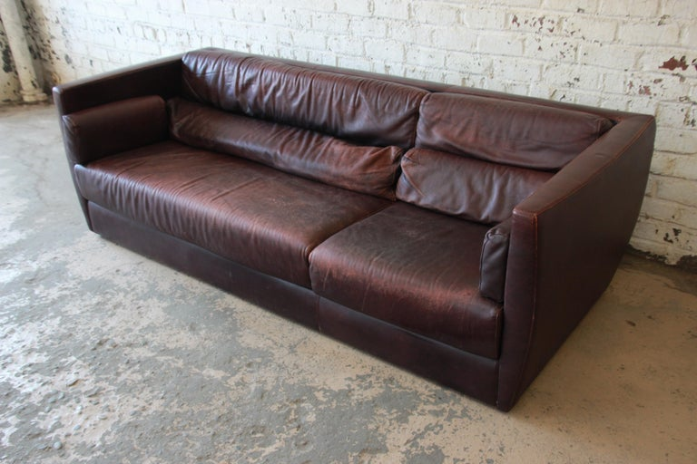 A gorgeous Bauhaus style leather sofa. The sofa was manufactured in Italy, circa 1970 by Tre Erre for Roche Bobois. It features gorgeous high-end leather in a deep burgundy, with a nice patina that only adds to the character and age of the piece.