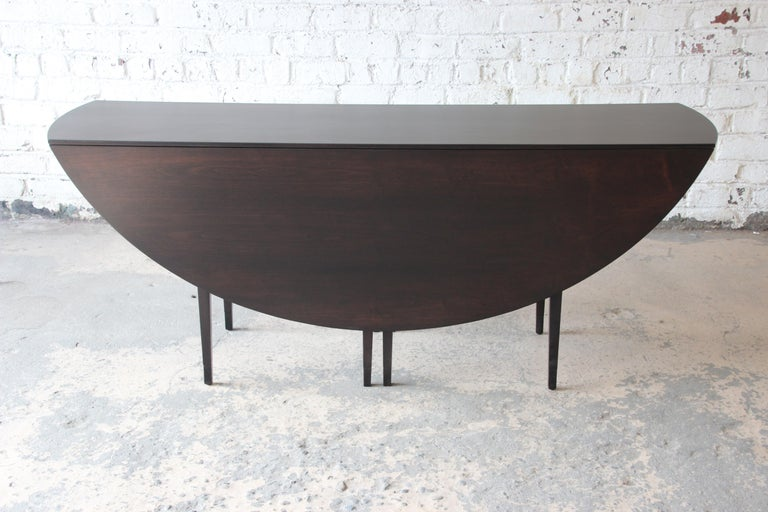 Mid-20th Century Edward Wormley for Dunbar Mid-Century Modern Walnut Oval Drop-Leaf Dining Table For Sale