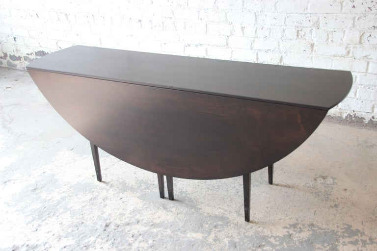 Leather Edward Wormley for Dunbar Mid-Century Modern Walnut Oval Drop-Leaf Dining Table For Sale