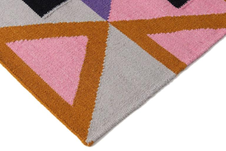 Modern, functional, sustainable. Make a statement with the Morgan design. It's is bold, colorful and unique. A geometric handwoven wool Dhurrie rug with a modern fresh approach. Designed by Aelfie.