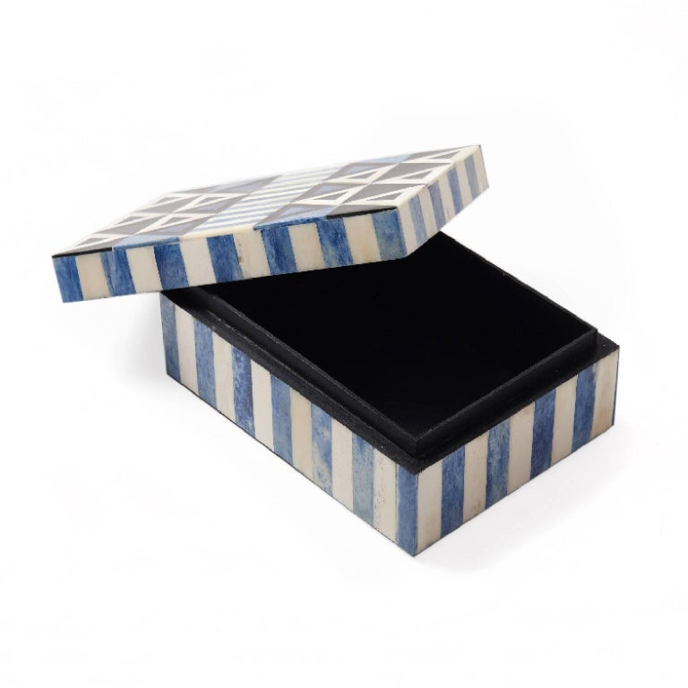 Tash your stuff in style.   Handcrafted using traditional bone inlay technique. The Okapi box is perfect for jazzing up the top of a dresser or desk.  Measures: 7