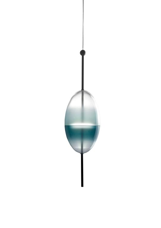 Flow[T] is a contemporary chandelier inspired by the colors of the Venetian lagoon and customised to the desires of each owner. Each piece enjoys its own shape, and in multiples, they create a sculptural display of lighting.  Light source: 18× SMD