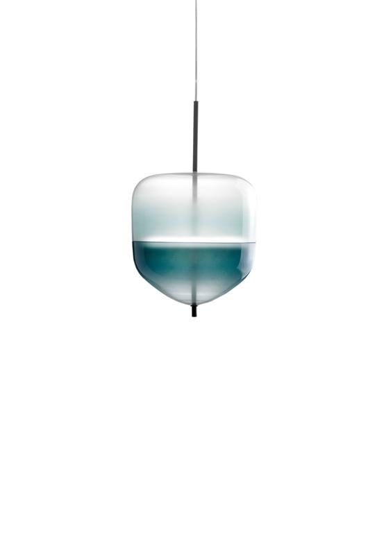 Flow[T] is a contemporary chandelier inspired by the colors of the Venetian lagoon and customized to the desires of each owner. Each piece enjoys its own shape, and in multiples, they create a sculptural display of lighting.