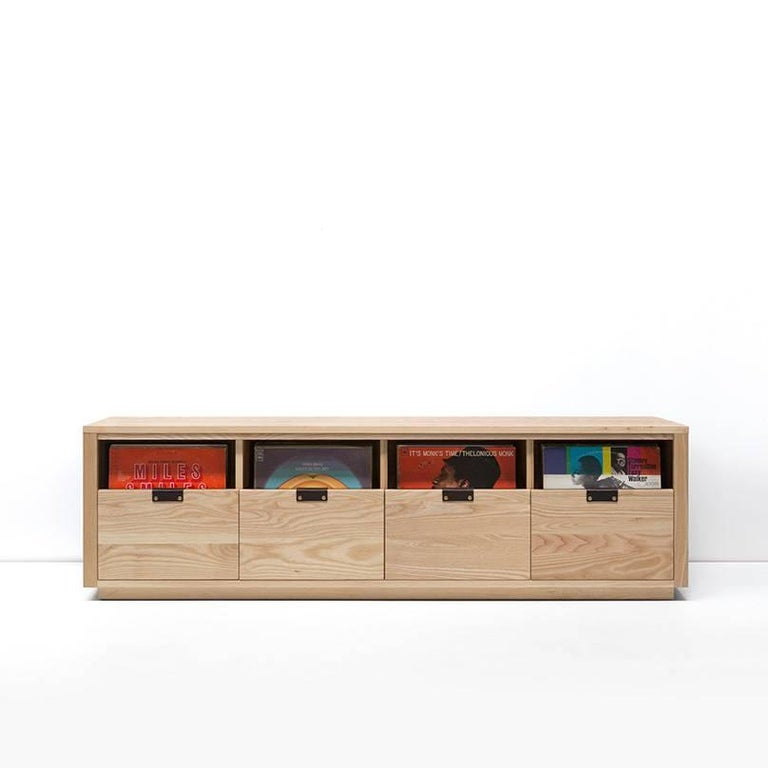 "Our dovetail vinyl storage cabinets utilize a ""file drawer"" approach to store LPs and allow you to easily flip through an entire record collection while enjoying a visual display of record cover art across the front of the cabinet. The design"