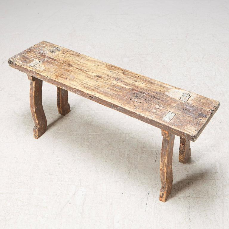 Early 19th century Swedish Folk Art bench with old patina. Signed and dated in 1816 under the seats.