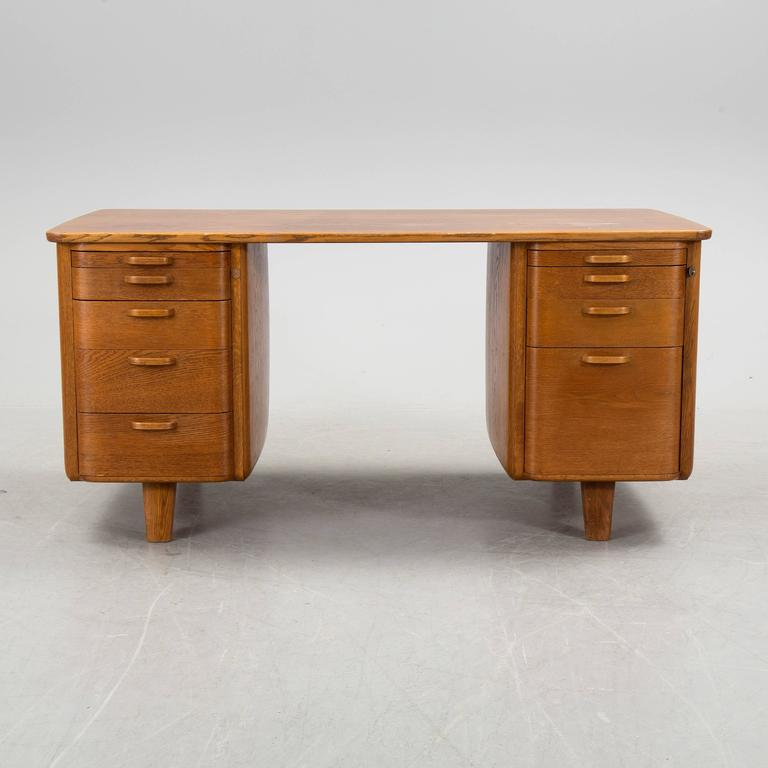Art Deco desk and swivel armchair made in teak by Gunnar Ericsson for Facit AB in Atvidaberg, Sweden, circa 1930.  Chair with original wool upholstery.  Excellent conditions.