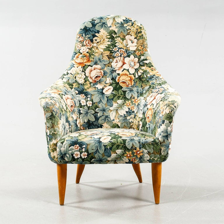 Pair of lounge chairs model 'Large Adam' and 'Little Adam' designed by Kerstin Horlin-Holmquist for Nordiska Kompaniet in Sweden, 1958.   Original vintage wool floral pattern upholstery in very good condition.  Measures:   'Little Adam'