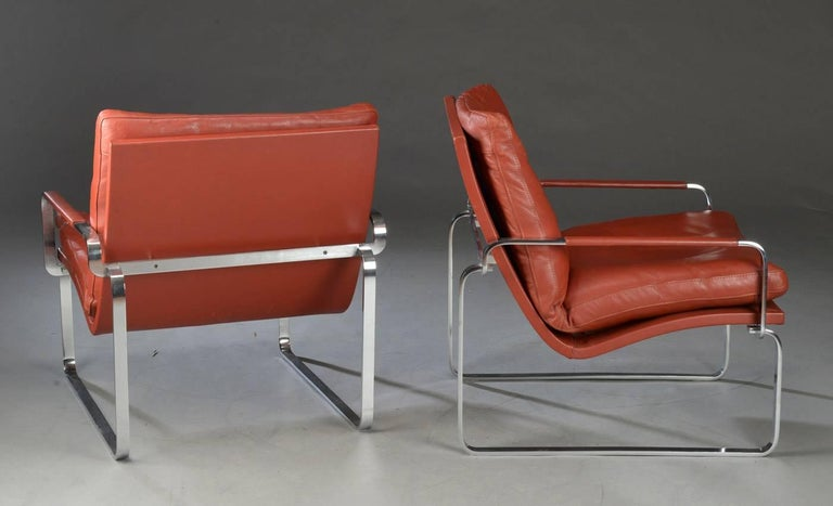 Pair of Danish easy chairs by Jørgen Lund & Ole Larsen, made in steel chromed and upholstered in leather. Produced by Bo-Ex in Denmark in 1960 in short production.