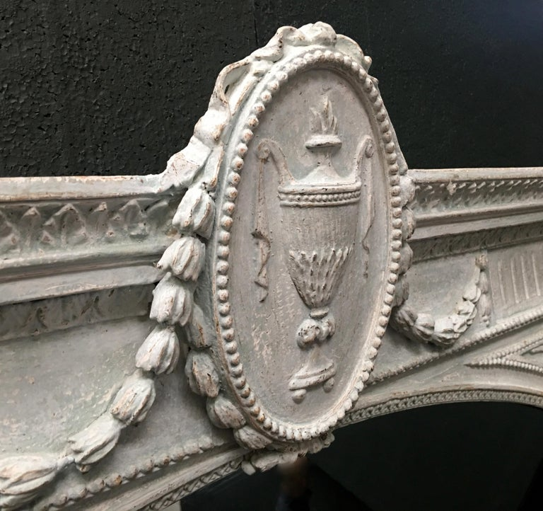 A stunning mid-19th century Adam style mirror of great proportions.   This mirror was sourced from a large 19th century beachfront residence in the south of England. When purchased, the mirror was covered in white household gloss paint. Our