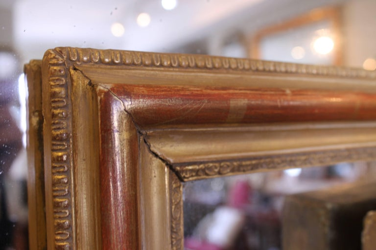 An excellent French mirror of useful size with good proportions to the design. The gilding has a pleasant evenly worn appearance with fine quality applied composition castings to the front and back edges, with a lovely warm, worn main burnished