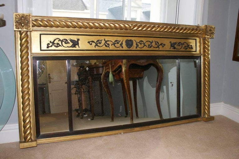 A good quality example of this style of mirror. This mirror has carved wood barley twist supports with reeded, ebonised inner frames (supporting the mirror plates). The main central panel has an applied Adam style composition design that has been