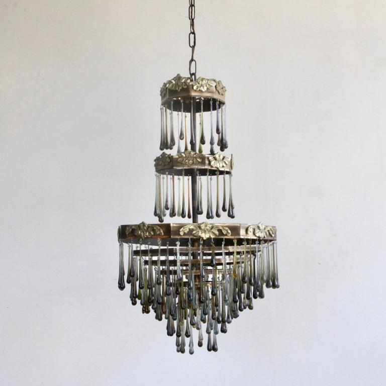 A 1920s French Waterfall chandelier frame dressed with handmade contemporary smokey glass teardrops. Chandelier uses four SBC fittings, B15. Supplied with chain and ceiling rose.