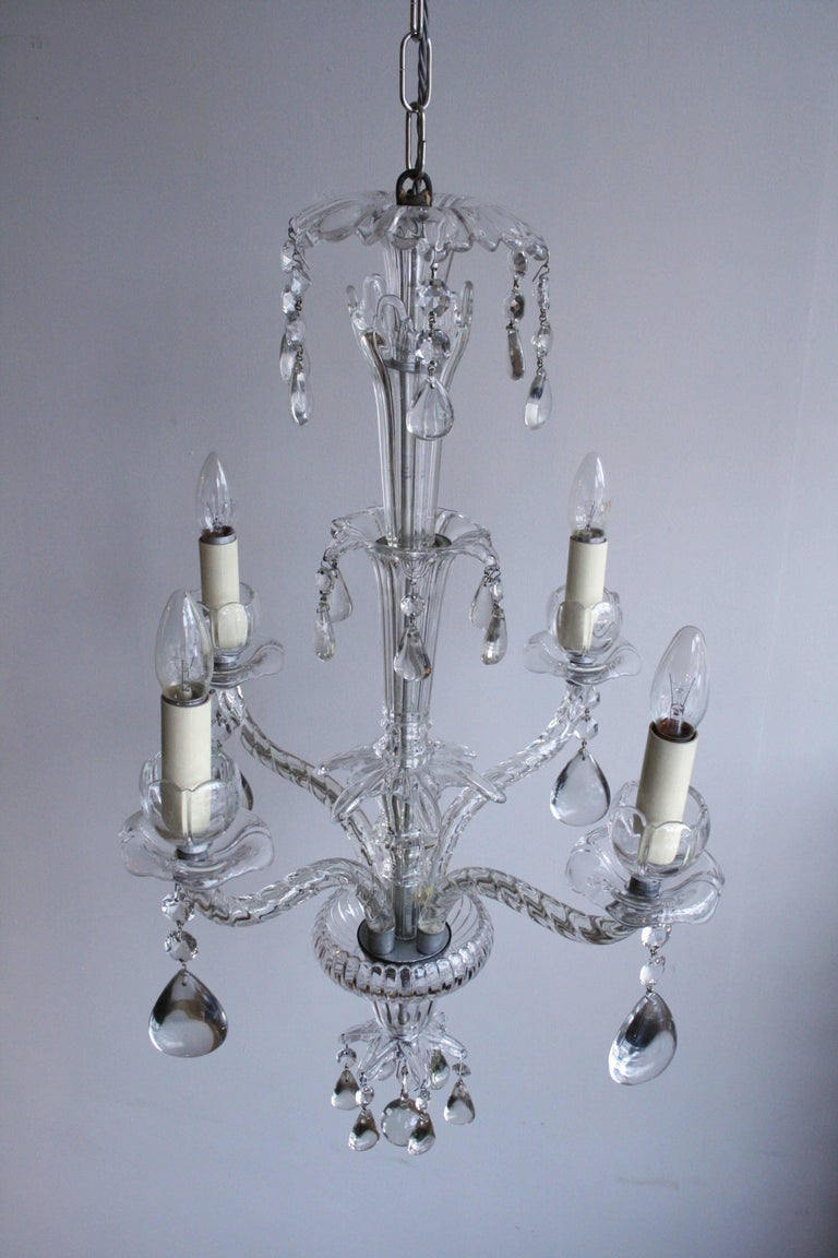Early 20th century moulded crystal chandelier with rounded crystal pear drops.