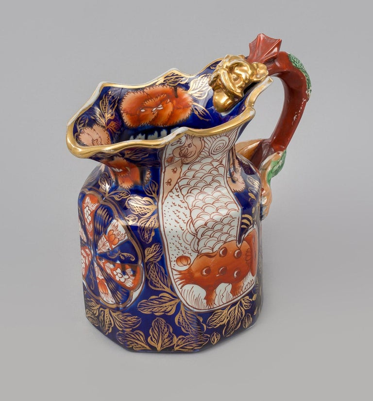 """A Mason's Ironstone China jug decorated in the """"Elephant's Foot"""" pattern, with well defined dragon handle with gilded head, glazed in the Imari colors of cobalt, orange and gilding. The base has the round impressed mark for Mason's."""