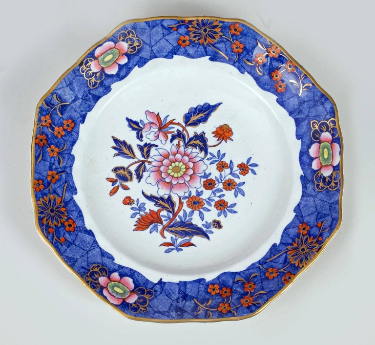 Copeland & Garrett Late Spode partial dessert service of ten pieces comprised of six octagonal plates and four shell shaped cake plates. The border is decorated in polychrome enamels of a cracked ice pattern of cobalt blue with pink flowers and