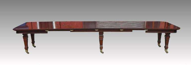 A truly stunning quality and impressive mahogany late Victorian extending dining table by the renowned furniture makers Gillows of Lancaster. The table stands on six square tapering fluted and moulded legs with original Copes patented stamped