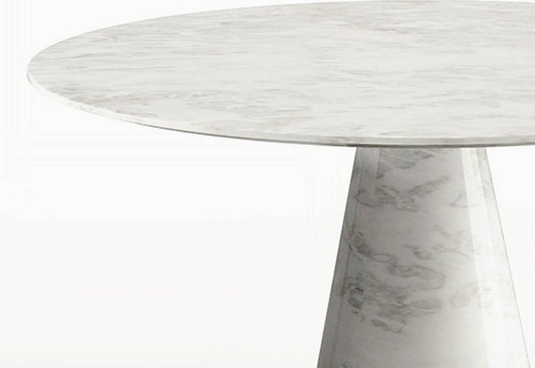 The Idee coffee table is a simple and elegant low table made out of pure marble. Its suitable to fit in a contemporary living room or a hotel lobby.  Materials: Marble Finish: Bianco Carrara Marble   Available in different sizes and marble finishes
