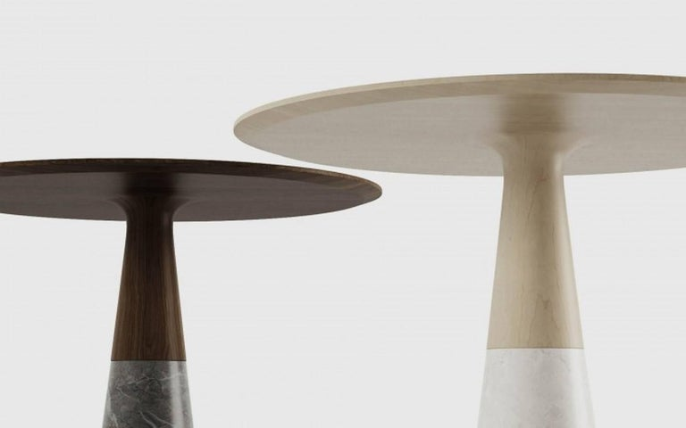 The echo round side table mixes marble with solid wood to reveal a design that is simultaneously sleek and striking. The famous french designer Christophe pillet created This table with Zen-like profile that inspires unheard-of moves.  Dimensions:
