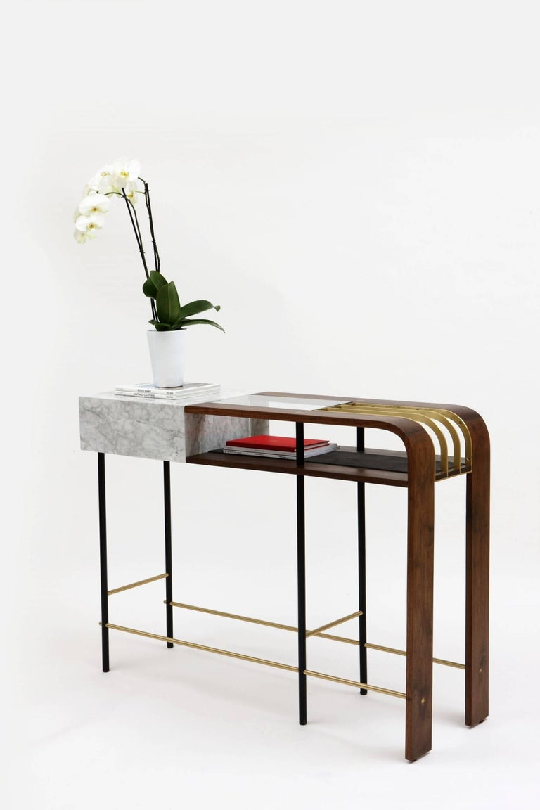The frame console takes inspiration from classical Art-Deco lines while having an overly exposed structural body. It plays on a philosophy of opposing ideologies: heavy yet light, old yet new, concealed yet revealed. It was conceived in order to