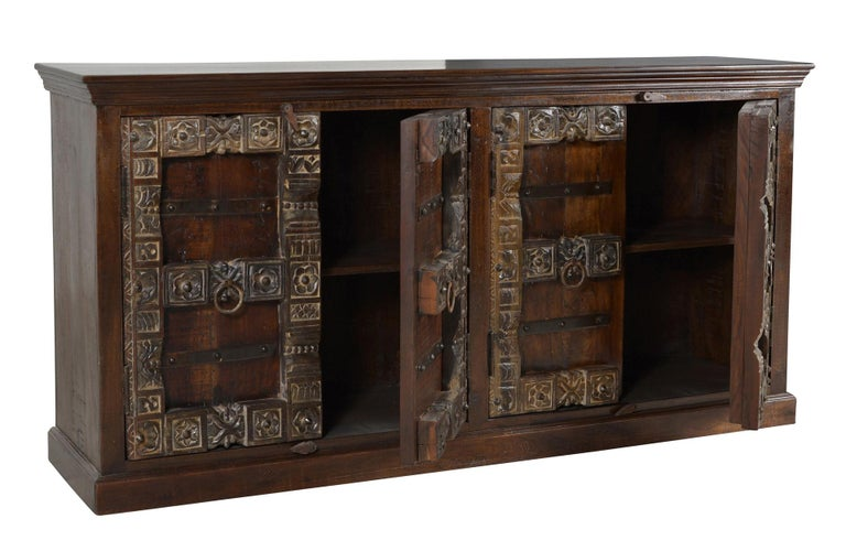 Made entirely of wood, the four doors buffet or sideboard has inner shelf in each compartment that divides the interior into two storage unites. Dimensions: W 180 cm x D 45 cm x H 90 cm Materials: Brown wood. Handmade in Germany.