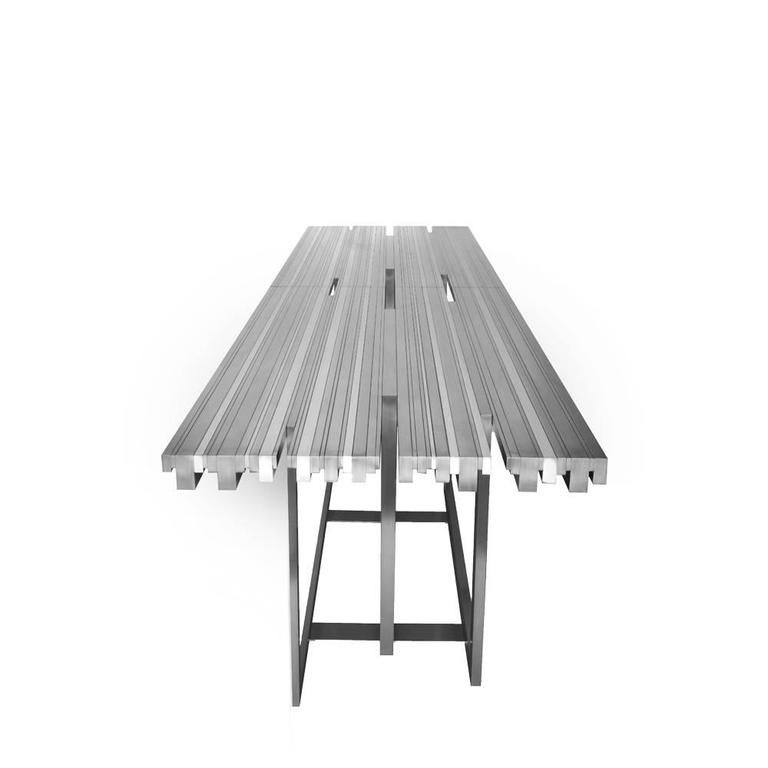 Contemporary rectangular dining table in brushed and mirror stainless steel sections. The Tempo table represents the speed at which a piece of music is played. This dining table represents the orchestra, while the elements of the table indicate the