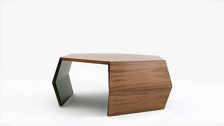 The hexagonal origami square coffee table by Nada Debs is offered in American walnut natural finish exterior / matte painted green interior.