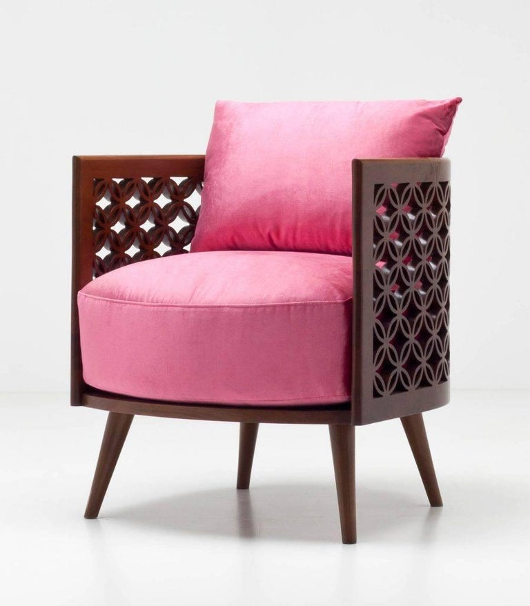 The set of two arabesque armchairs in American walnut eggshell finish and upholstered in royal pink satin color represents the traditional craftsmanship of the Middle East with the restraint of a Japanese aesthetic. Nada who was brought up in Japan