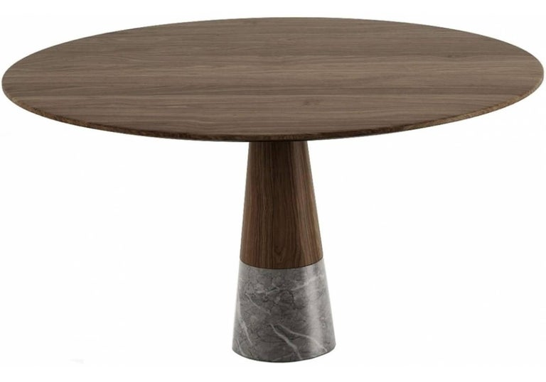 Echo is a round solid wood and marble dining table designed by Christophe Pillet. The famous French designer applied the principle of modern simplicity to create a design that is simultaneously sleek and striking. Materials: Wood and stone Finishes: