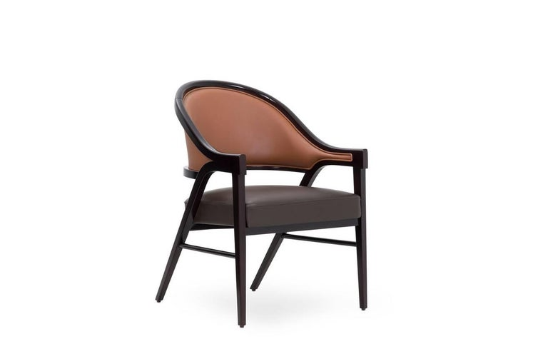 Timeless lounge chair upholstered in a harmonic mix of dark and light high quality genuine brown leather. The ebony structure of the chair with the feminine curves provides strength and lightness to the piece . By Paulo Antunes Suitable for