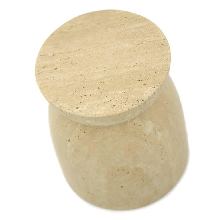 Upon first glace, one can see that the Japan Table is the personification of a cork. Designed as a table or a stool, this version of the Japan is made in solid travertine marble. The piece features pure lines, or veins, documenting the pure and