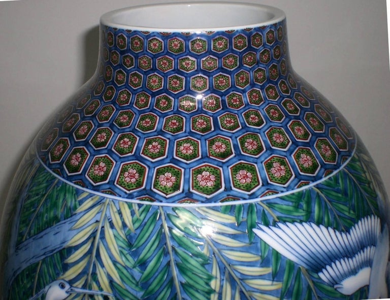 Unique Japanese Imari contemporary decorative porcelain vase, hand-painted on a stunningly shaped body, a masterpiece by master porcelain artist of the Imari-Arita region of southern island of Kyushu in Japan (1931-2009). He was admired for his