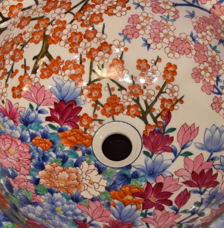 Unique Japanese, handcrafted, hand-painted porcelain washbasin by highly an acclaimed award-winning master porcelain artist from the Imari-Arita region in Japan. The outer surface of this magnificent washbasin is pure white. If you are looking for