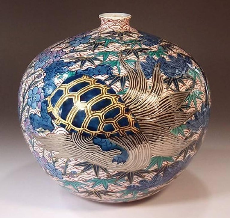 Unique intriguing Japanese contemporary decorative porcelain vase, gilded and hand painted on a beautifully shaped ovoid pure white porcelain body, a signed work by highly acclaimed master porcelain artist of the historic Imari-Arita region of
