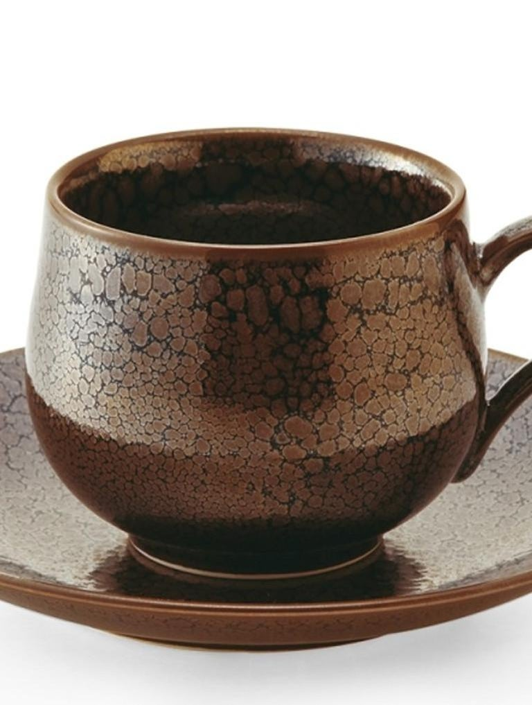 Unique contemporary Japanese hand-glazed porcelain cup and saucer in chocolate brown, a signed masterpiece by widely respected award-winning master porcelain artist in