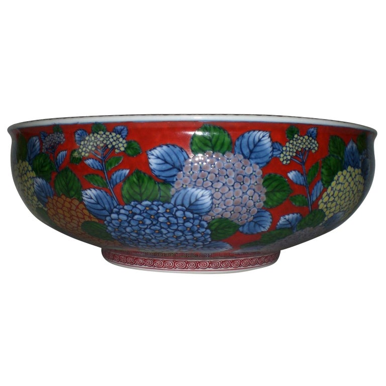 Exceptional Japanese contemporary decorative porcelain bowl/centerpiece, intricately hand painted on a beautifully shaped body in red and blue, a signed masterpiece by second-generation master porcelain artist of the Imari-Arita region of Japan.