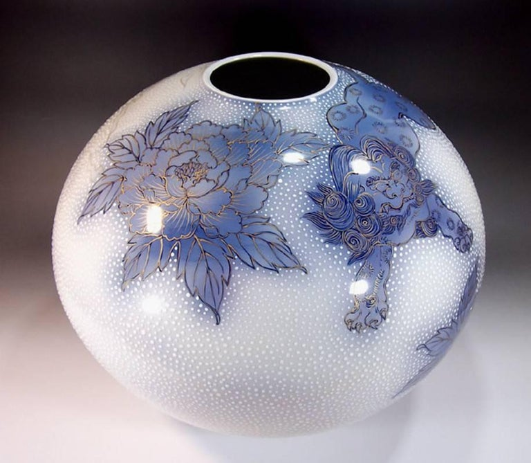 Exquisite very large gilded Japanese contemporary decorative porcelain vase, hand painted in beautiful shades of blue on an elegantly shaped ovoid porcelain body with generous gold details, is by a highly respected award-winning master porcelain