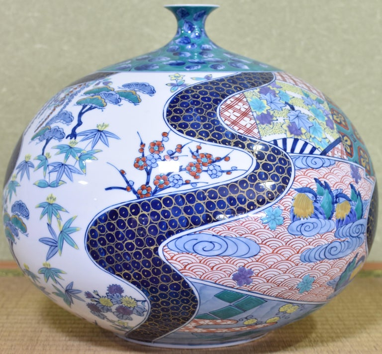 Exceptional Japanese large ovoid decorative porcelain vase, hand painted on a stunningly shaped porcelain body in blue and red, a masterpiece by highly-acclaimed award-winning master porcelain artist in Japan's Imari-Arita region. It is divided into