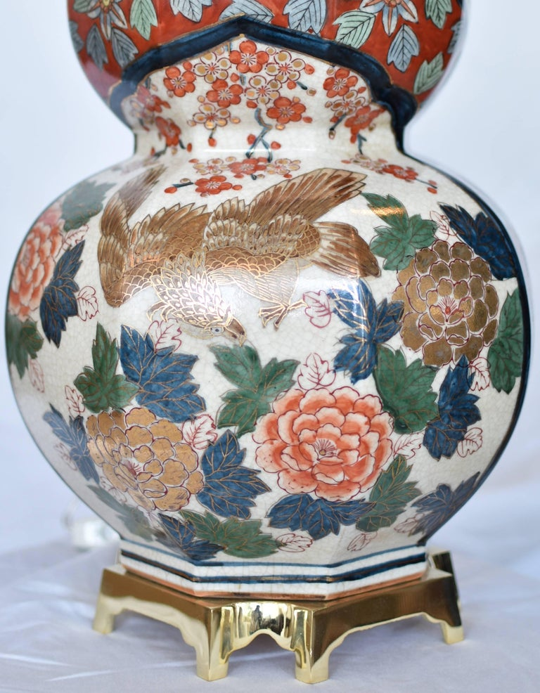 This unique one-of-a-kind massive vintage Japanese Imari gilded and hand-painted lamp in a breathtaking double gourd crackled fine porcelain, showcases two panels with creamy white background, one depicting two stunning elegant cranes strolling